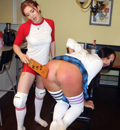 Missy Martinez learns about the sting of the pledge paddle